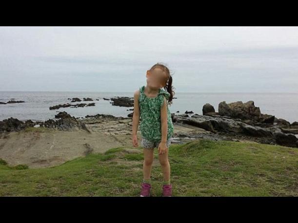 Japón: Le tomaba una foto a su hija hasta que algo raro apareció
