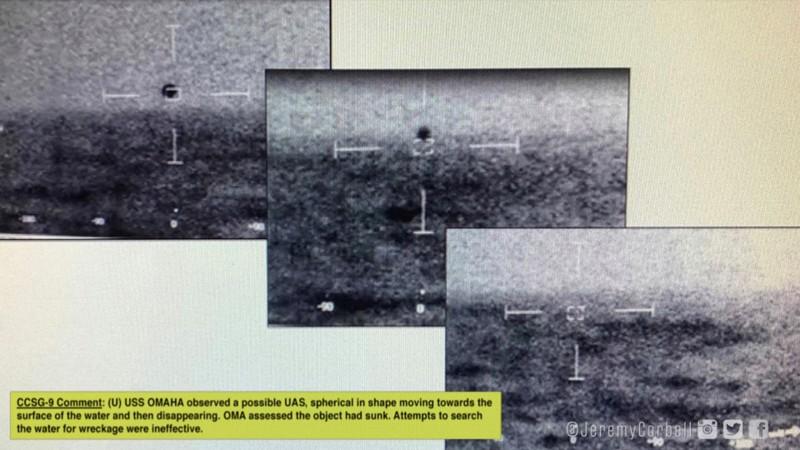 Imágenes de la marina que muestran la esfera trans-media viajan desde el aire hasta el agua